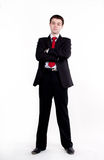 Young business man standing with arms crossed Stock Images