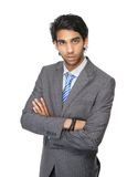 Young business man standing with arms crossed Stock Photo