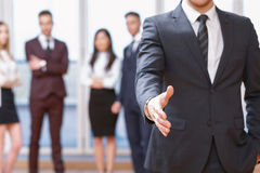 Young business man standing in front of his co Stock Photography