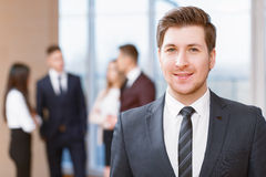 Young business man standing in front of his co Royalty Free Stock Photos