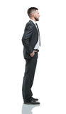 Young business man standing with hands in pocket over white back Royalty Free Stock Photography