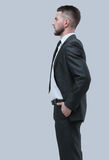 Young business man standing with hands in pocket over white back Royalty Free Stock Photo