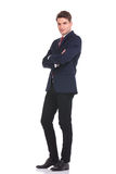 Young business man standing with his hands crossed. Royalty Free Stock Image