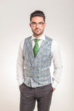 Young business man standing with his hands in pockets Royalty Free Stock Photos