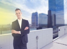 Young business man standing with office building background royalty free stock photo