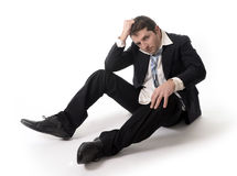 Young Business Man in Stress on the floor Stock Image