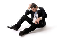 Young Business Man in Stress on the floor Royalty Free Stock Image