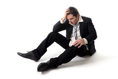 Young Business Man in Stress on the floor Royalty Free Stock Photo