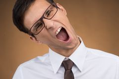 Young business man or student screaming. Royalty Free Stock Photo