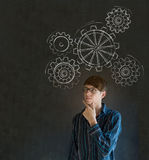 Man thinking with turning gear cogs or gears Royalty Free Stock Photo