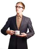 Young business man in suit with cup Royalty Free Stock Photography