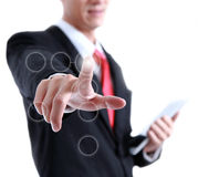 Young business man in a suit pointing with his finger Royalty Free Stock Photos