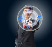 Young business man in a suit pointing with his finger Stock Images