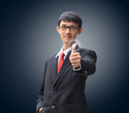 Young business man in a suit pointing with his finger Stock Photos