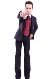 Young business man in suit pointing at you Stock Photo