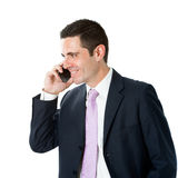 Young business man in suit talking on smart phone. Royalty Free Stock Photos