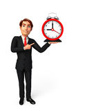 Young Business Man with table clock Royalty Free Stock Photography