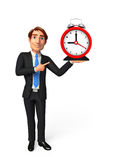 Young Business Man with table clock Stock Photo