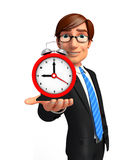 Young Business Man with table clock Stock Image