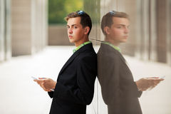 Young business man with tablet computer at the wall Royalty Free Stock Photography