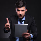 Young business man with tablet shows ok Stock Image