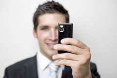 Young business man takes a picture Stock Photography