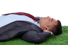 Young business man taking a nap Royalty Free Stock Photography