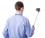 Young business man taking selfie photo with smart phone on selfi Stock Photo