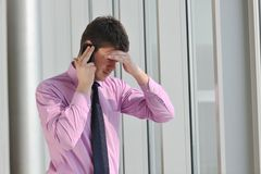Young business man talk by cellphone Royalty Free Stock Photo