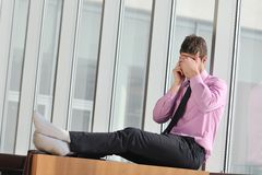 Young business man talk by cellphone Royalty Free Stock Photos