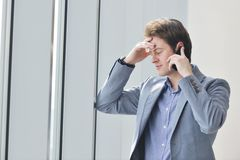 Young business man talk by cellphone Stock Photography