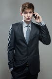Young business man talking on cell phone Royalty Free Stock Image