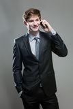 Young business man talking on cell phone Royalty Free Stock Images