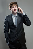 Young business man talking on cell phone Stock Photos