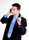 Young business man talking on  cellphone Stock Photography