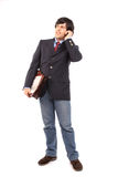 Young business man talking on cellphone Royalty Free Stock Photos