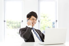 Young business man talking happily by smart phone Royalty Free Stock Photo