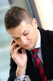 Young business man talking on the phone Stock Photography