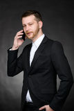 Young business man talking on smartphone Stock Photos