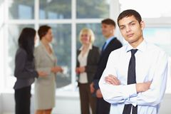 Young business man with team Royalty Free Stock Images