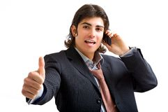 Young business man with telephone. Young business man take a phone call Royalty Free Stock Images