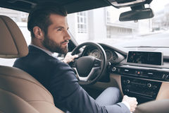 Young business man test drive new car. Young business person test drive new vehicle driving Stock Photography