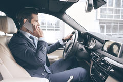 Young business man test drive new car Stock Images