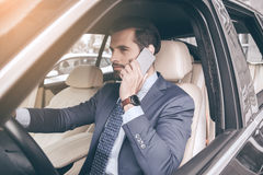 Young business man test drive new car Stock Photos