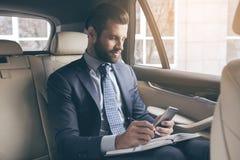 Young business man test drive new car Stock Photos