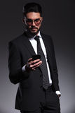 Young business man texting on his smartphone Royalty Free Stock Photos