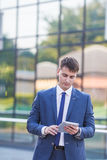 Young business man think look up hold tablet pc Stock Image