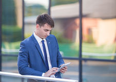 Young business man think look up hold tablet pc Stock Photography