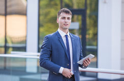 Young business man think look up hold tablet pc Royalty Free Stock Photo