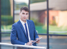 Young business man think look up hold tablet pc Stock Images